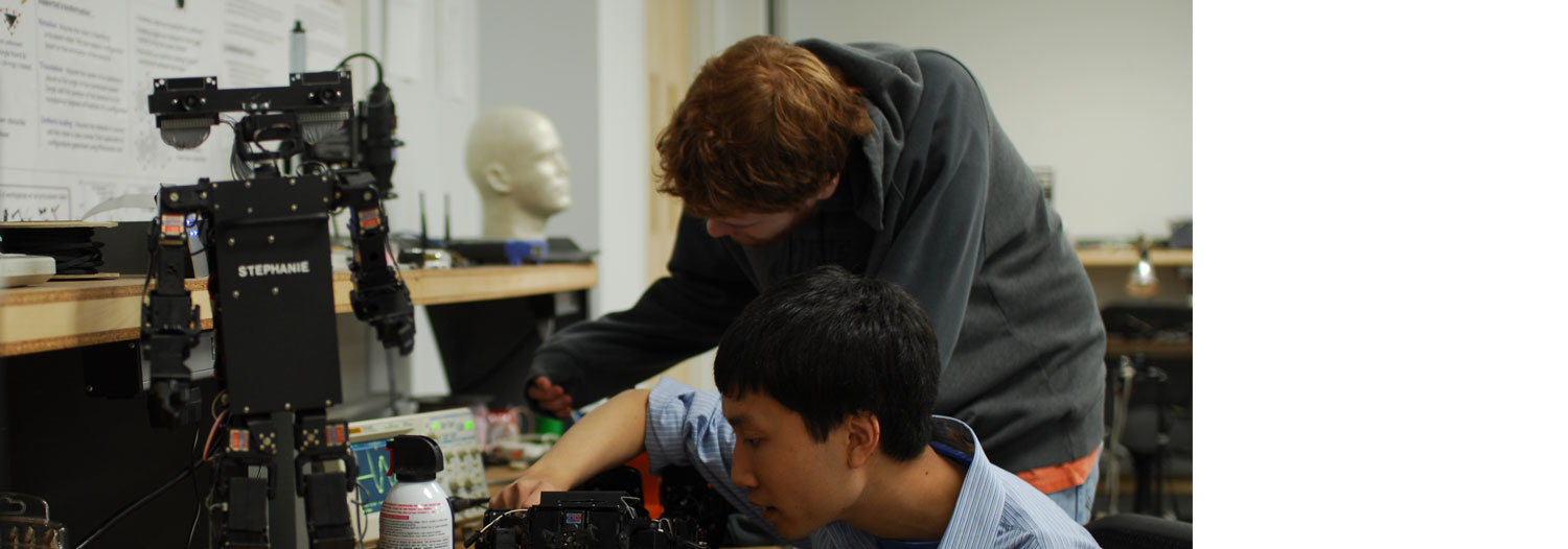 Slide Image: Members of the Applied Robotics Club working together.