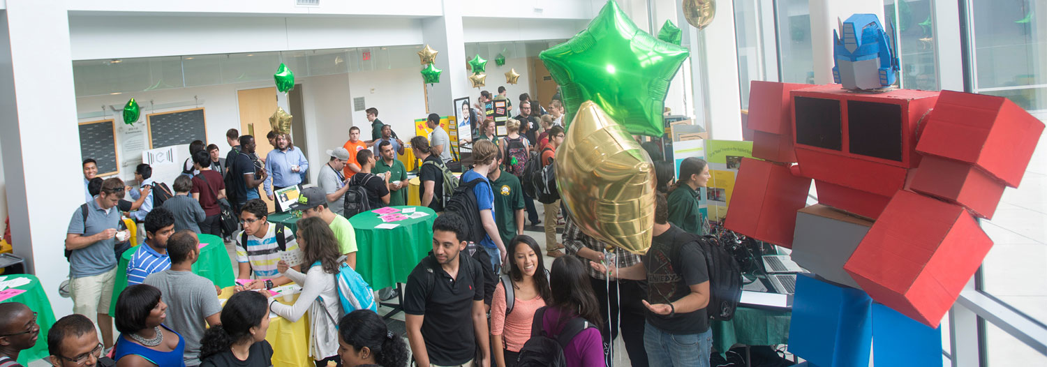 Slide Image: Students and faculty attend the Volgenau School of Engineering Ice Cream Social.